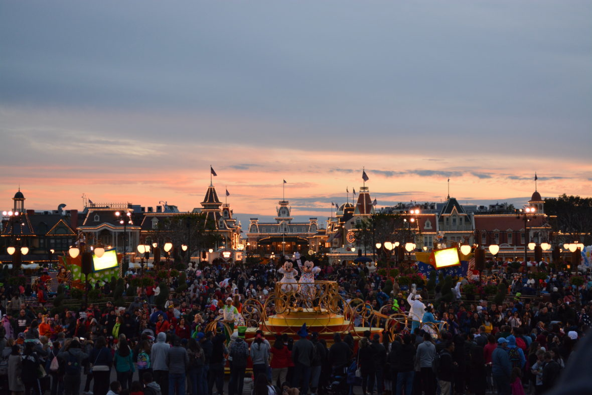 View of the hub in Magic Kingdom at sunset as Mickey and Minnie lead the Move It, Shake It, MousekaDance It Street Party