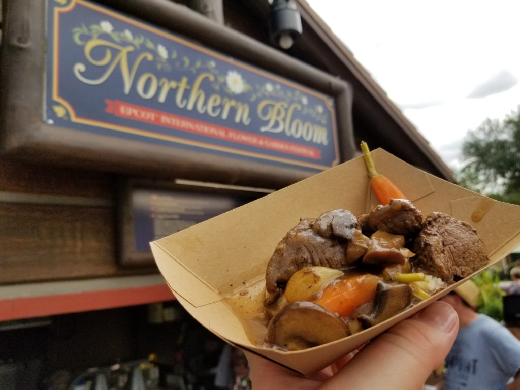 Beef Tenderloin Tips with Mushroom Bordelaise Sauce, Whipped Potatoes and Garden Vegetables in front of the Northern Bloom booth in the Canadian Pavilion