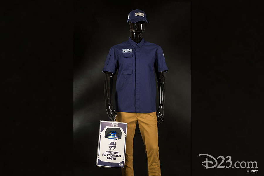 Mannequin wearing Droid Depot Clothing and holding a box with a droid in it.