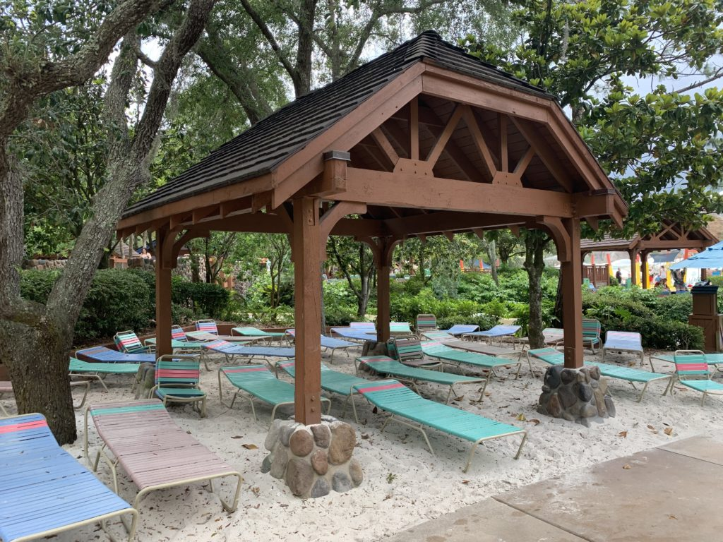 Lounge chairs under an awning at Blizzard Beach.