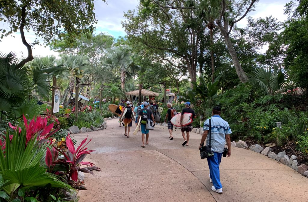 A group heading to a private surf event at Disney's Typhoon Lagoon water park.